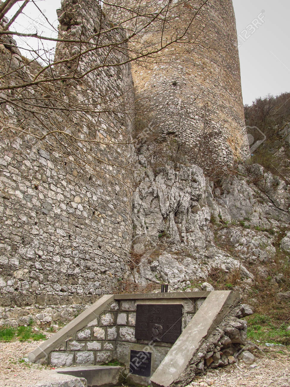 Golubac, Serbia, March 29, 2012: Ruins of castle with a commemorative plaque in the place where Zawisza Czarny, a famous Polish knight, symbol of courage and righteousness killed by the Turks in 1428 - 157894969