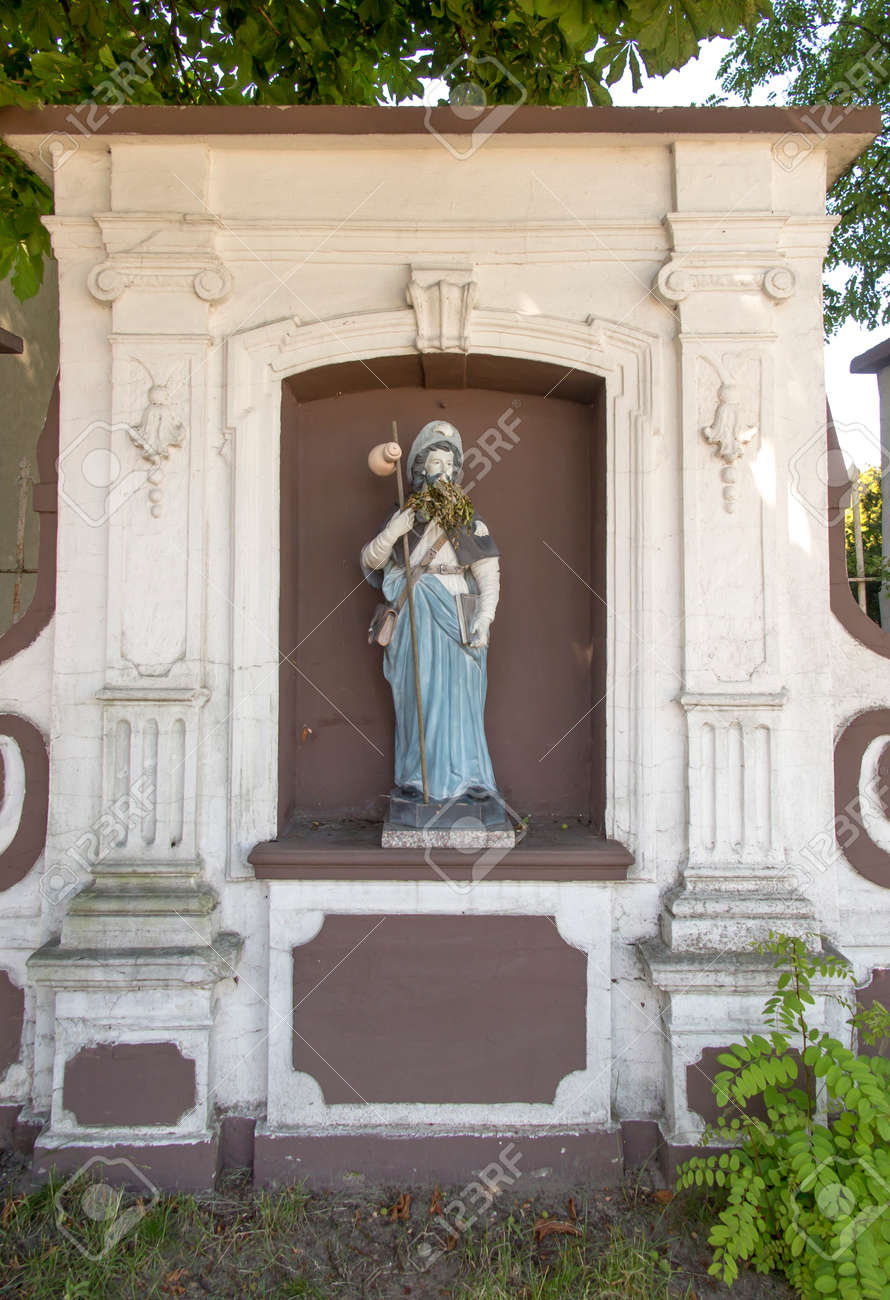 Figurine of St. James placed on the pilgrimage route to Santiago de Compostela (Camino) near the church of St. Jakub in Saczow in Poland. Two pilgrimage routes descend here: Jasnogorska and Via Regia. - 158013571