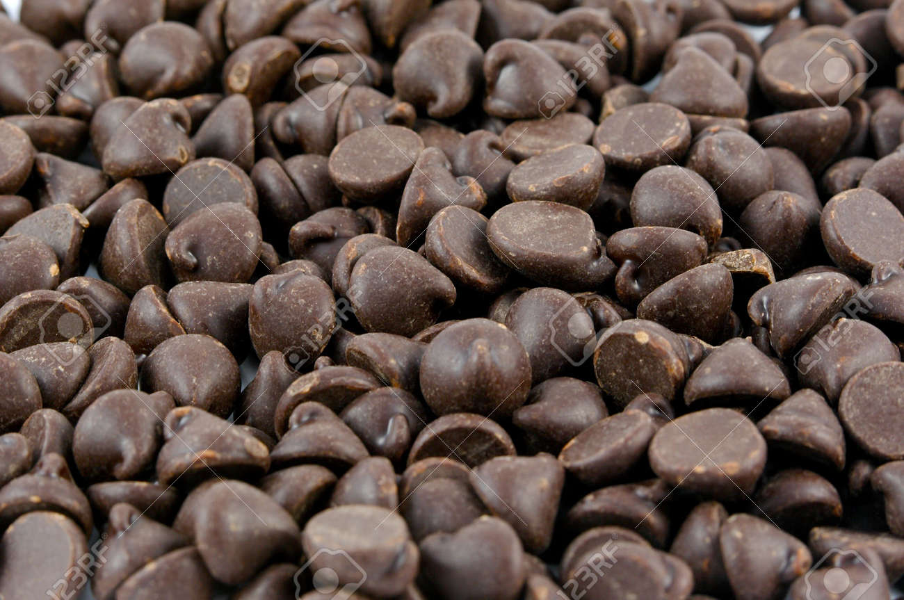 Dark Chocolate Chips Background Texture Stock Photo, Picture And ...