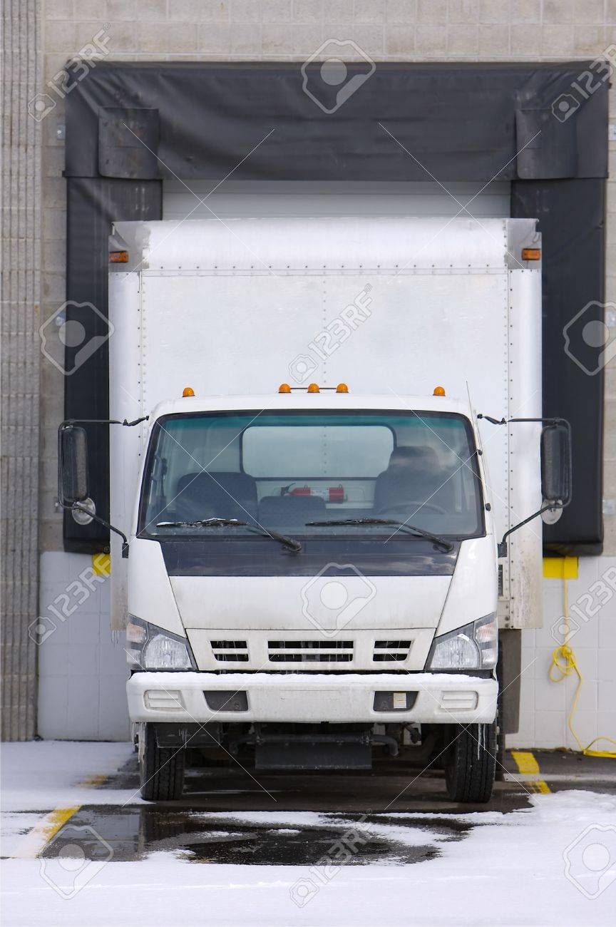 cargo truck loading or unloading at docking bay Stock Photo - 345275