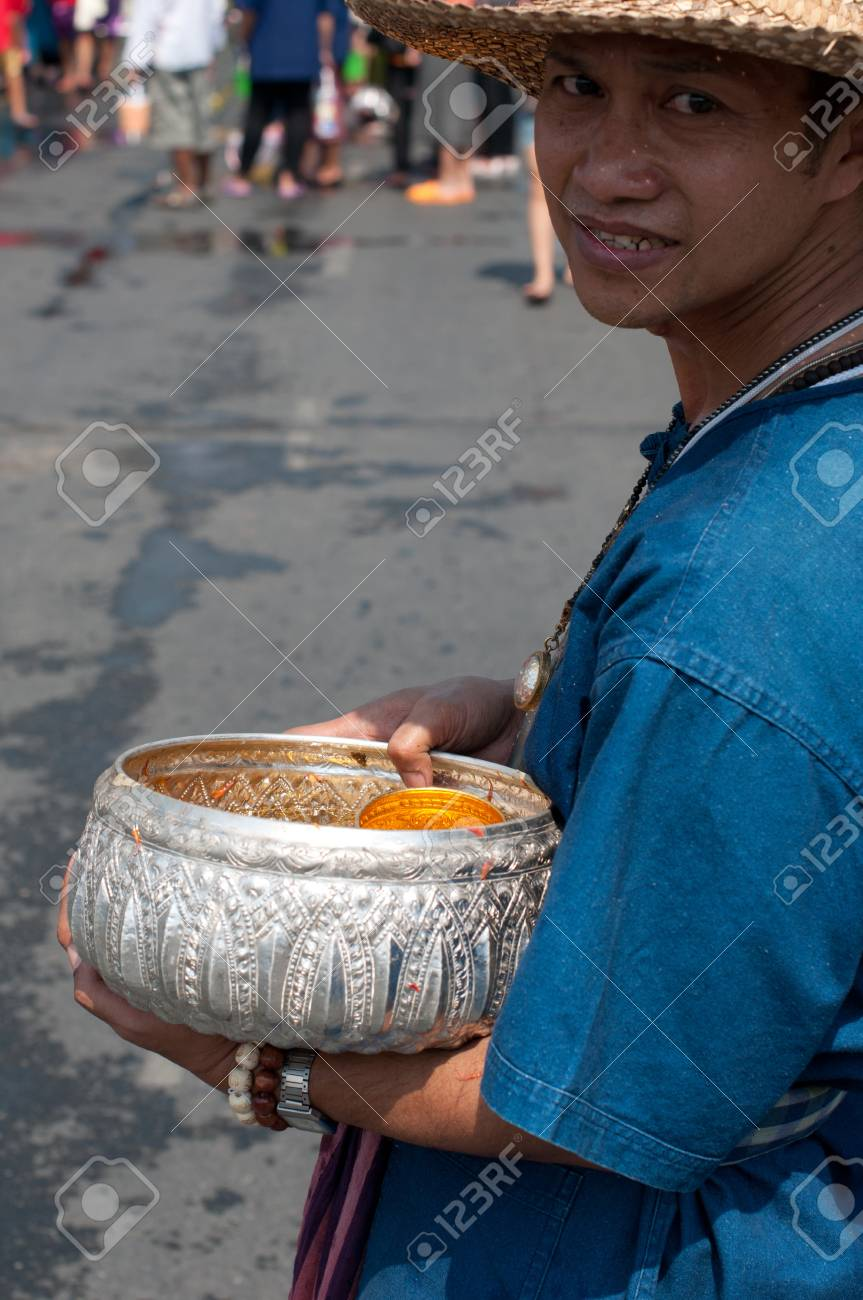 CHIANG MAI, THAILAND - APRIL 13:Undentified beautiful with traditionally dressed woman in parade on Songkran Festival on April 13, 2012 in Chiang Mai, Thailand  Stock Photo - 13244016