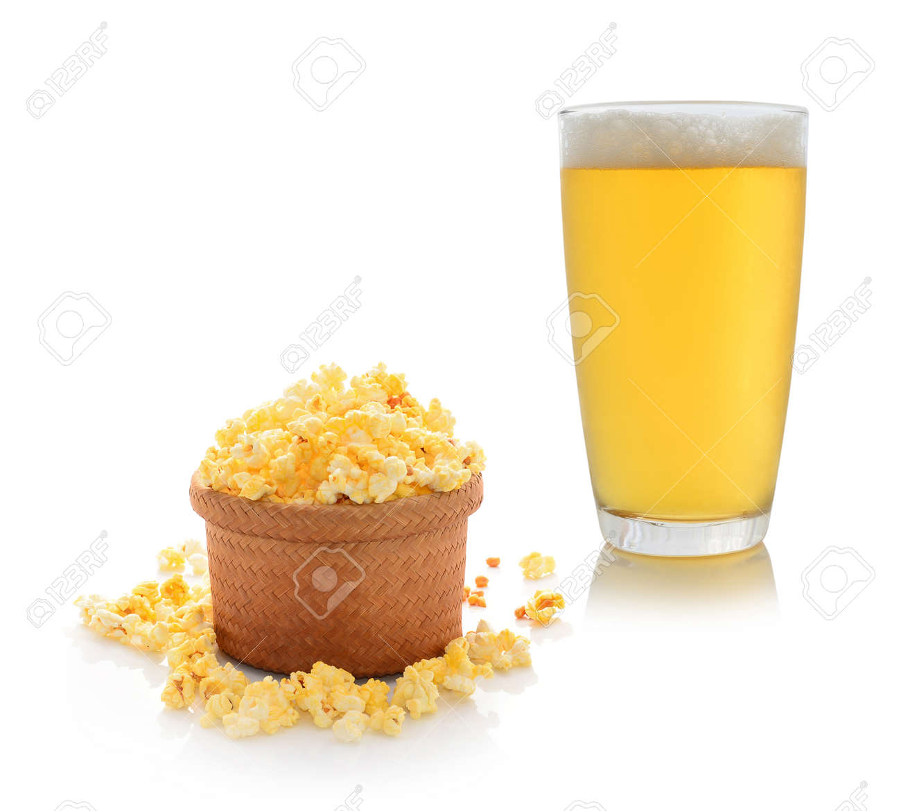 A glass of beer with popcorn Stock Photo - 22882998