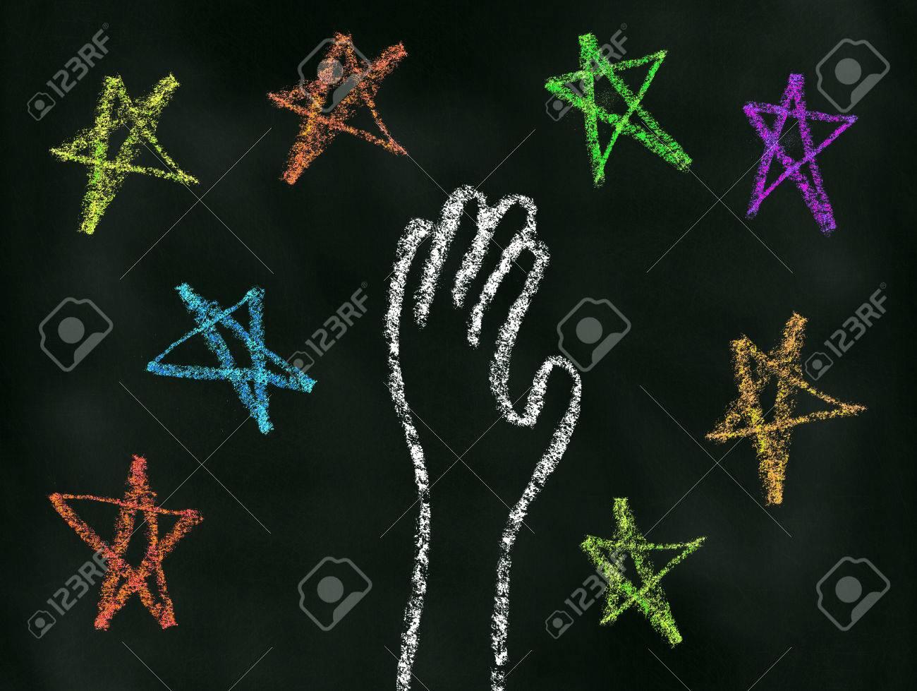 黒板の星イラストに手を伸ばす手 の写真素材画像素材 Image 53891793