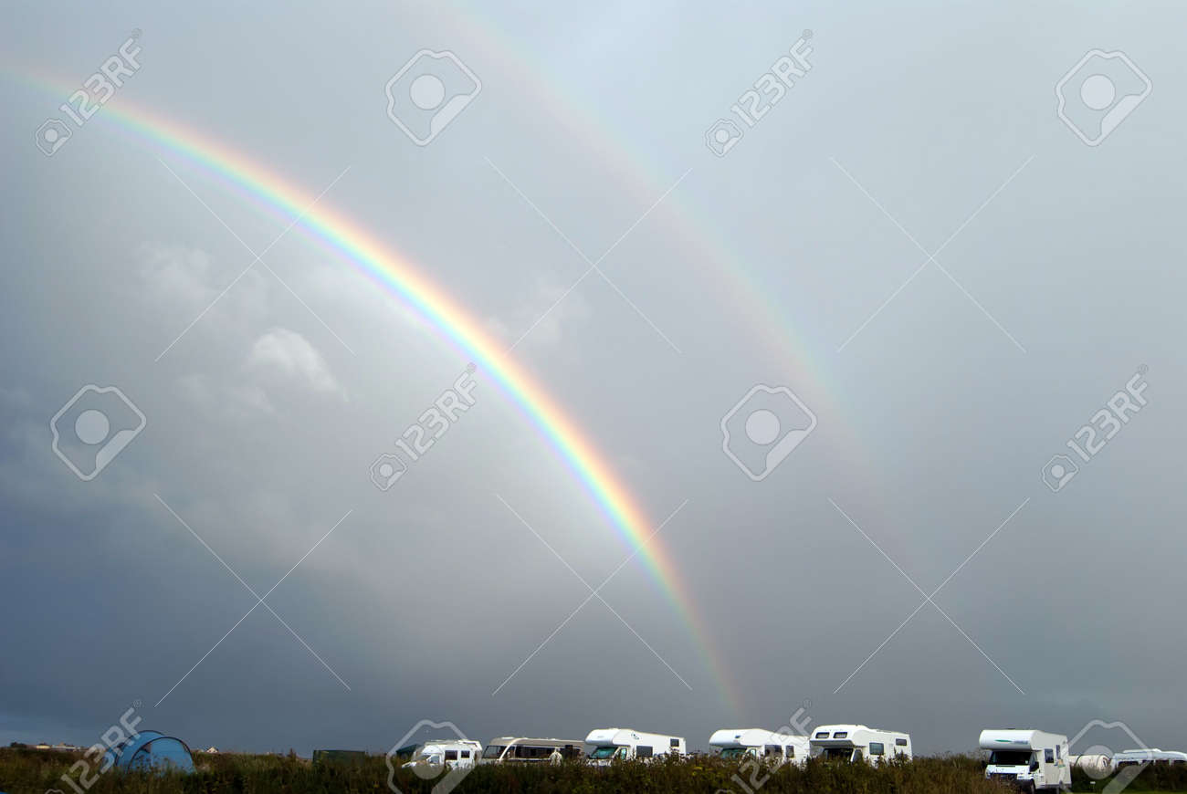 colorful rainbow at the sky over the campsite Stock Photo - 8063681