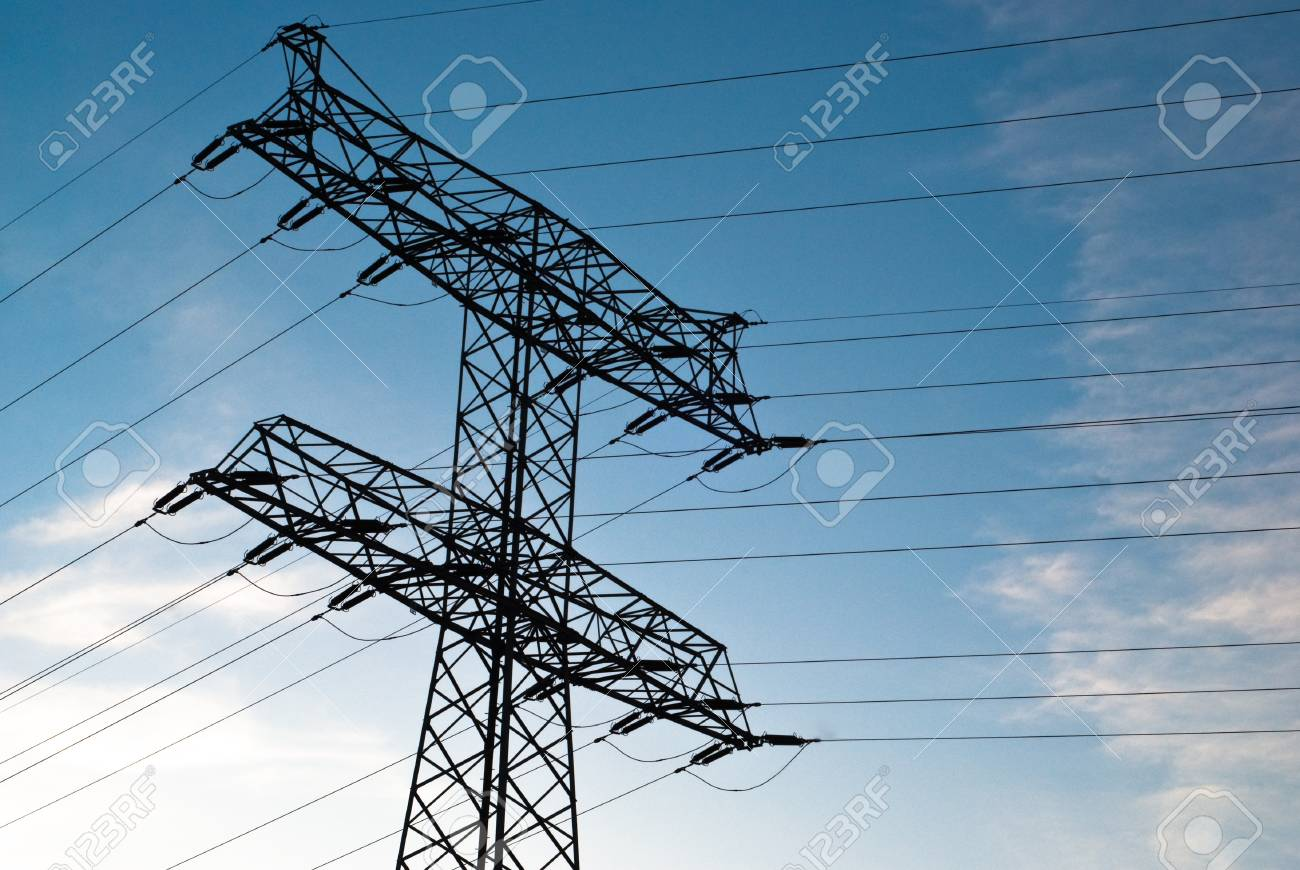 large electricity pylon against blue sky with clouds Stock Photo - 8366242