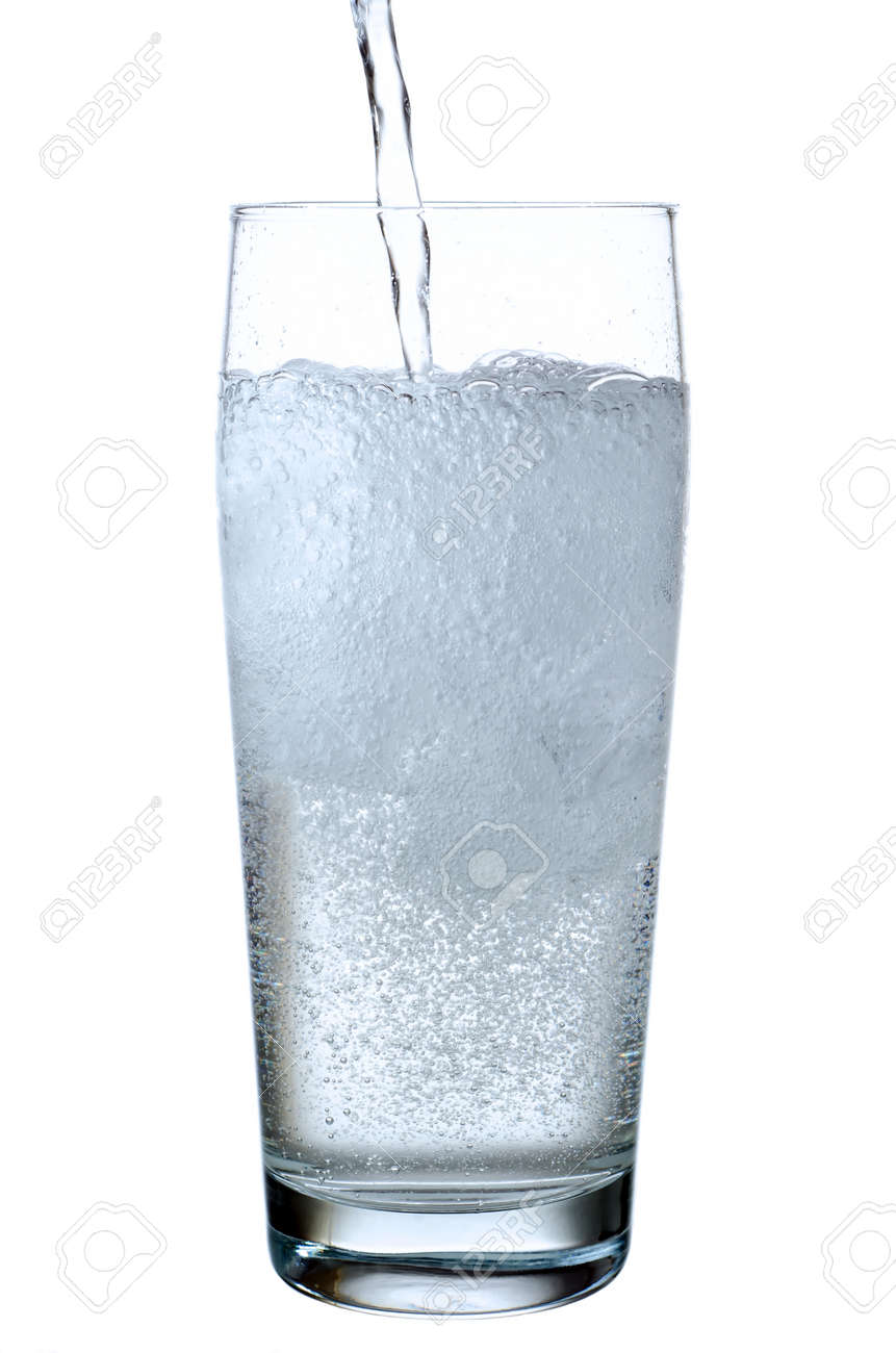 a glass filled with mineral water before white background - 15884340