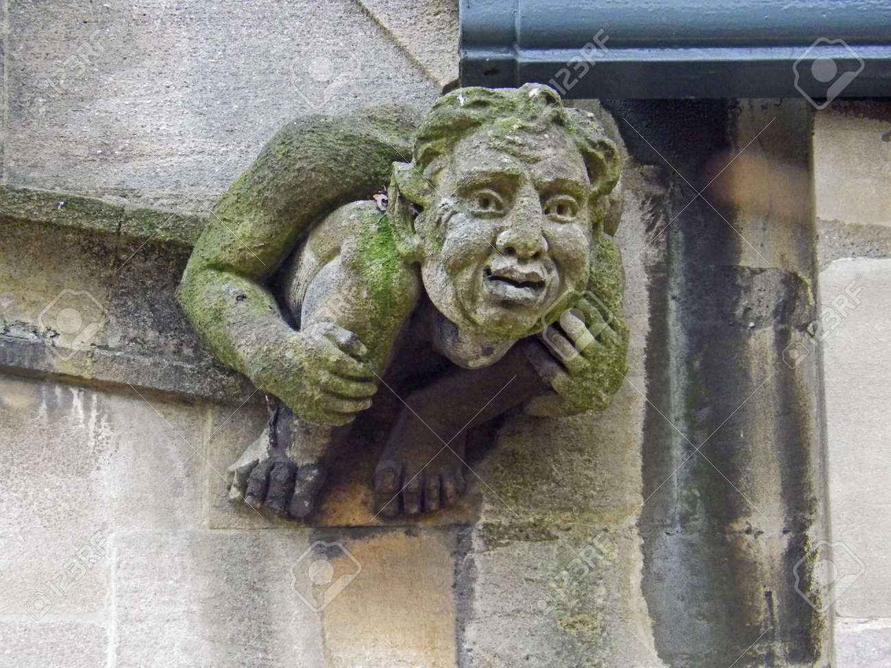 A Weather Worn Or Weather-beaten Stone Gargoyle Or Grotesque ...