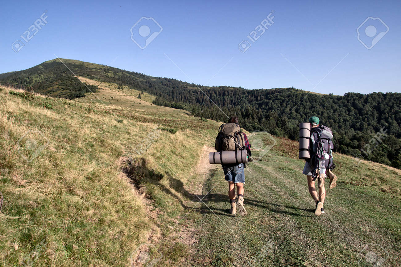Tourists are walking in the mountians, day - 84124557