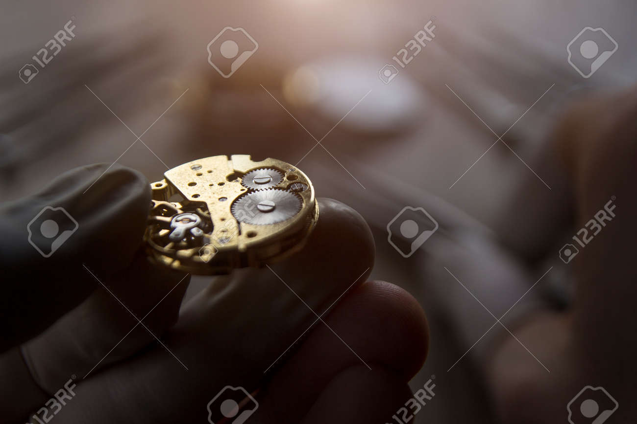 Watchmaker is repairing the mechanical watches in his workshop - 88611916