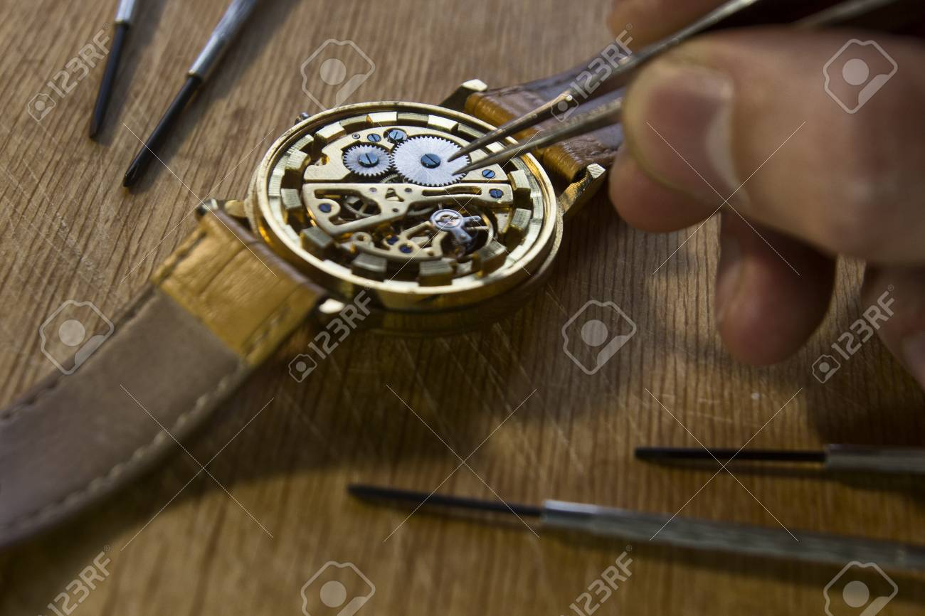Watchmaker is repairing the mechanical watches in his workshop - 89223789