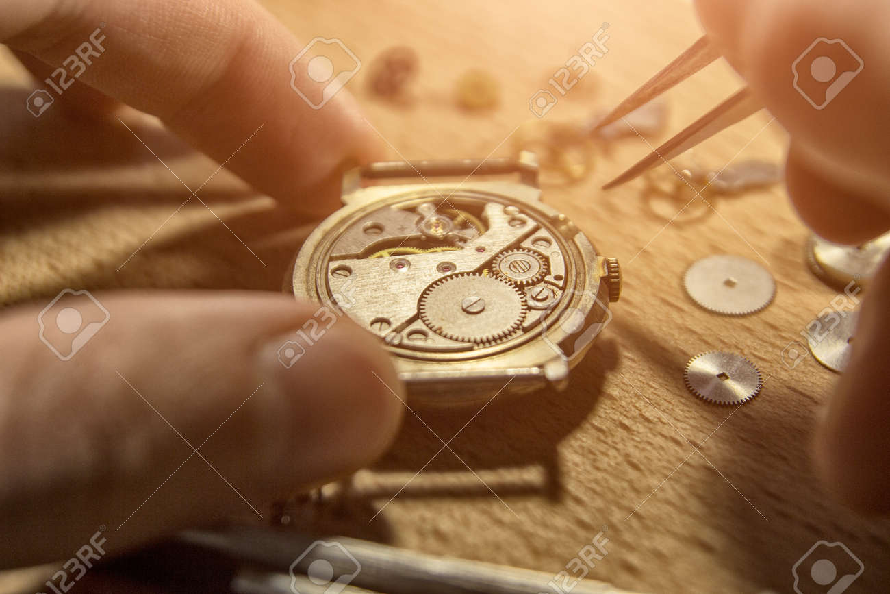 Watchmaker is repairing the mechanical watches in his workshop - 93282965