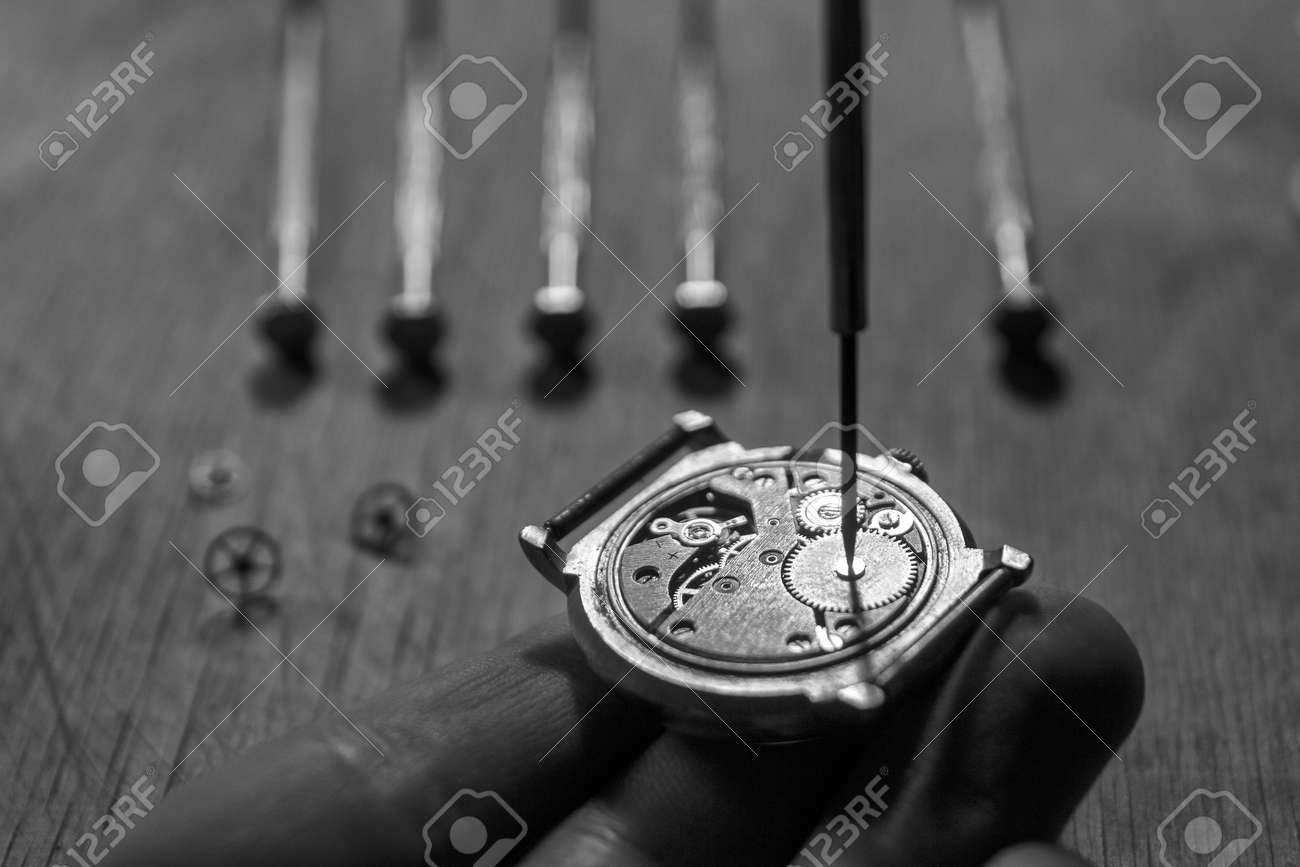 Watchmaker is repairing the mechanical watches in his workshop - 93319531