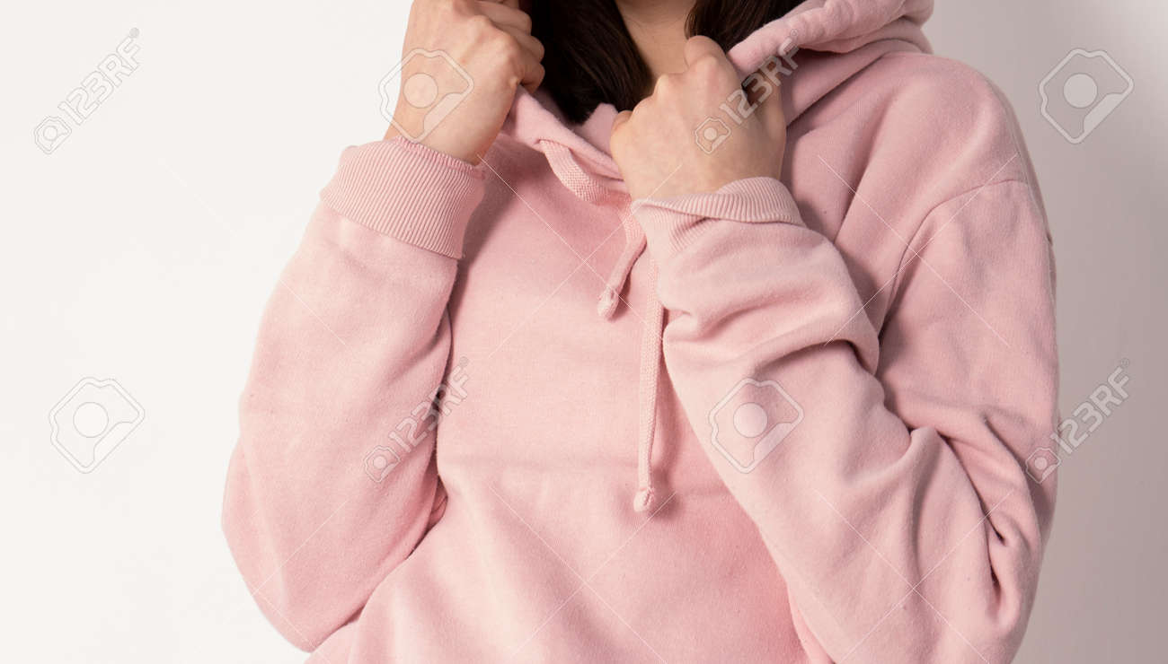 Girld in a pink hoodie - 157190198