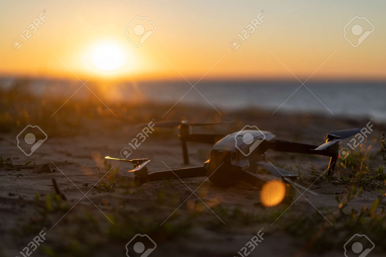 Drone on the ground, sunset - 153349559