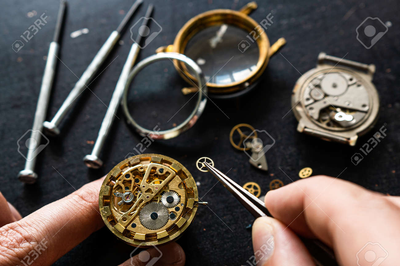 Watchmaker is repearing mechanical wrist watch - 155783743