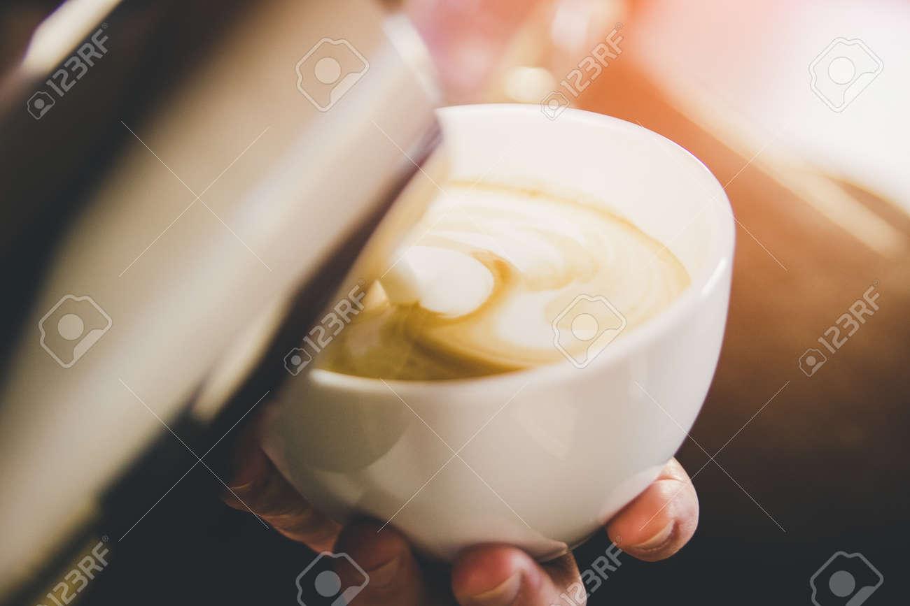 Hand on Barista making latte cafe - 155783825