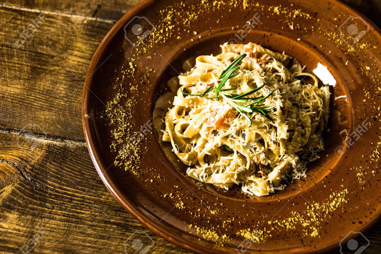 Delicious italian pasta on wooden background - 155783375