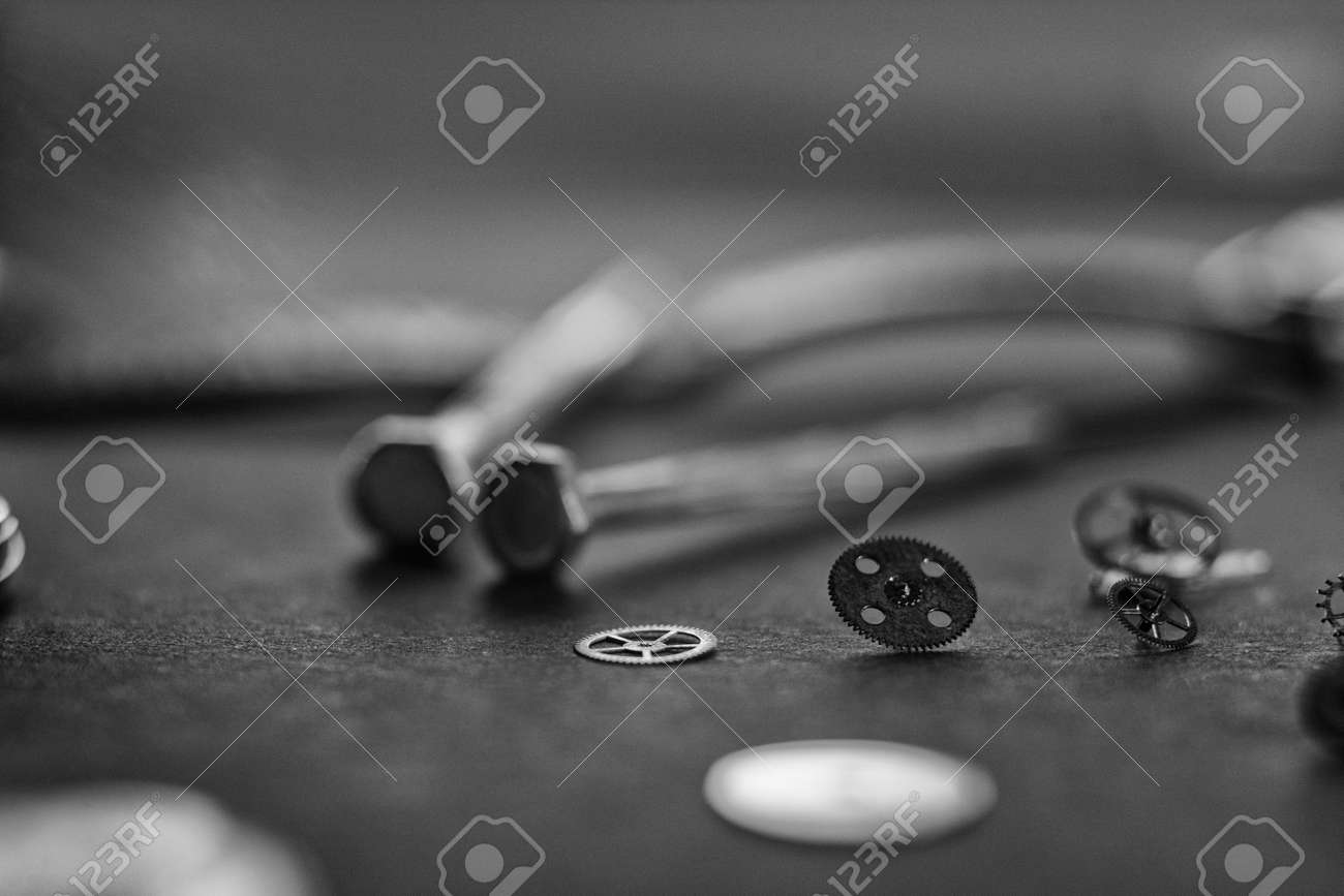 Mechanical watch assembly, watchmakers workshop with many parts and gears - 158412643