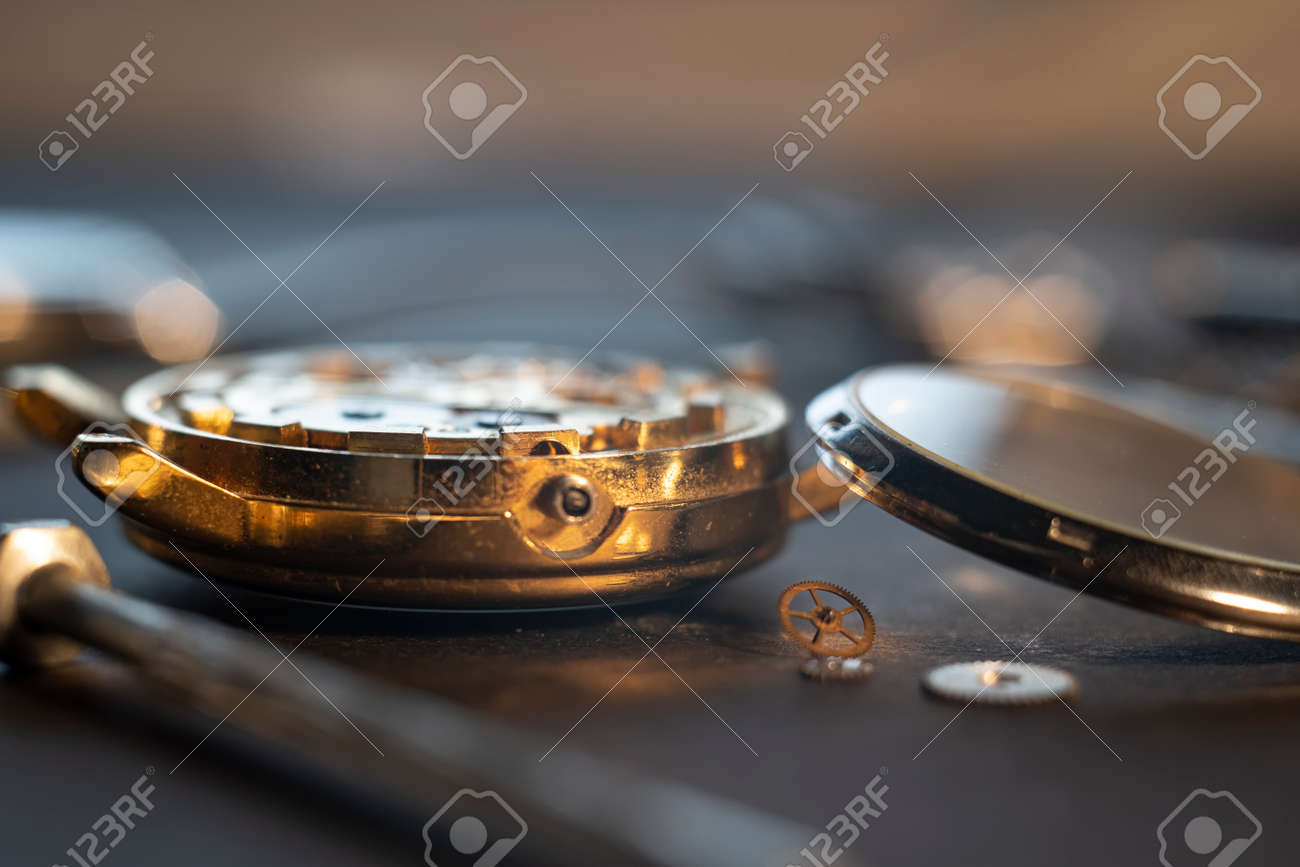 Mechanical watch assembly, watchmakers workshop with many parts and gears - 158412651