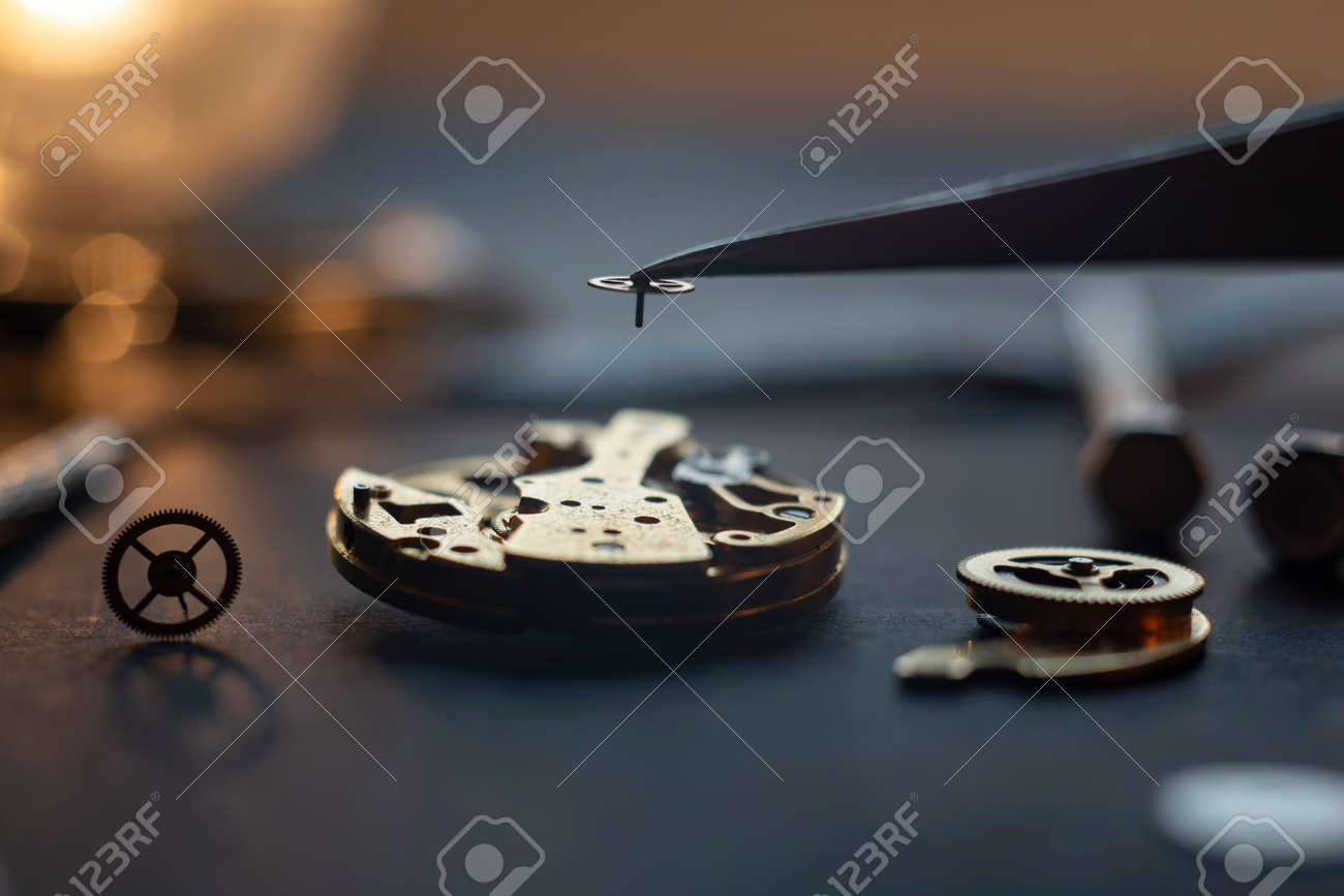 Mechanical watch assembly, watchmakers workshop with many parts and gears - 158412656
