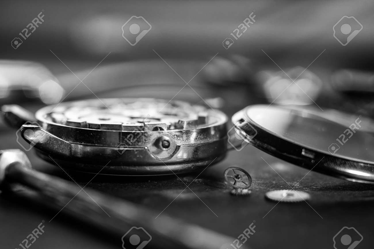 Mechanical watch assembly, watchmakers workshop with many parts and gears - 158412661