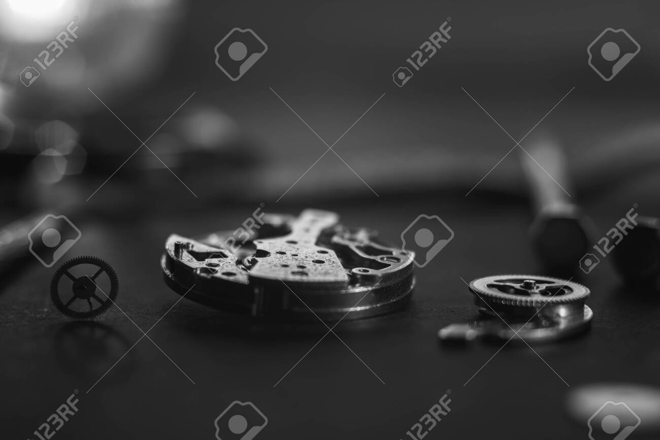 Mechanical watch assembly, watchmakers workshop with many parts and gears - 158412666