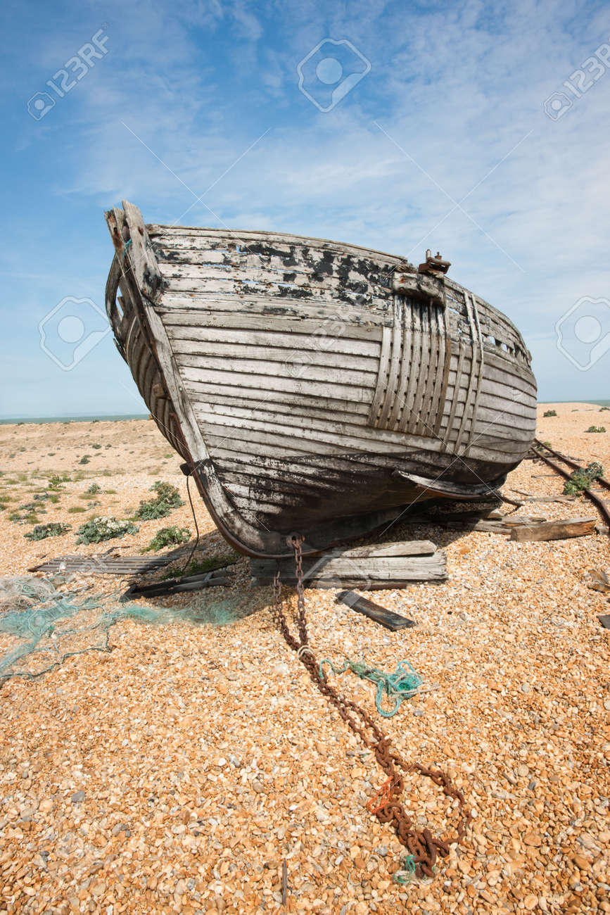 Abandoned shipwreck of wood fishing boat on beach against blue sky Stock Photo - 4902993