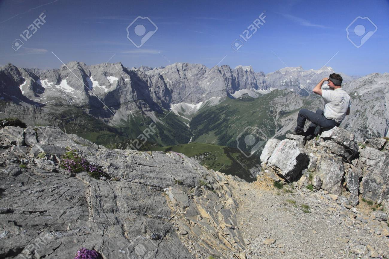 a man is viewing  to mountains from top Stock Photo - 9759887
