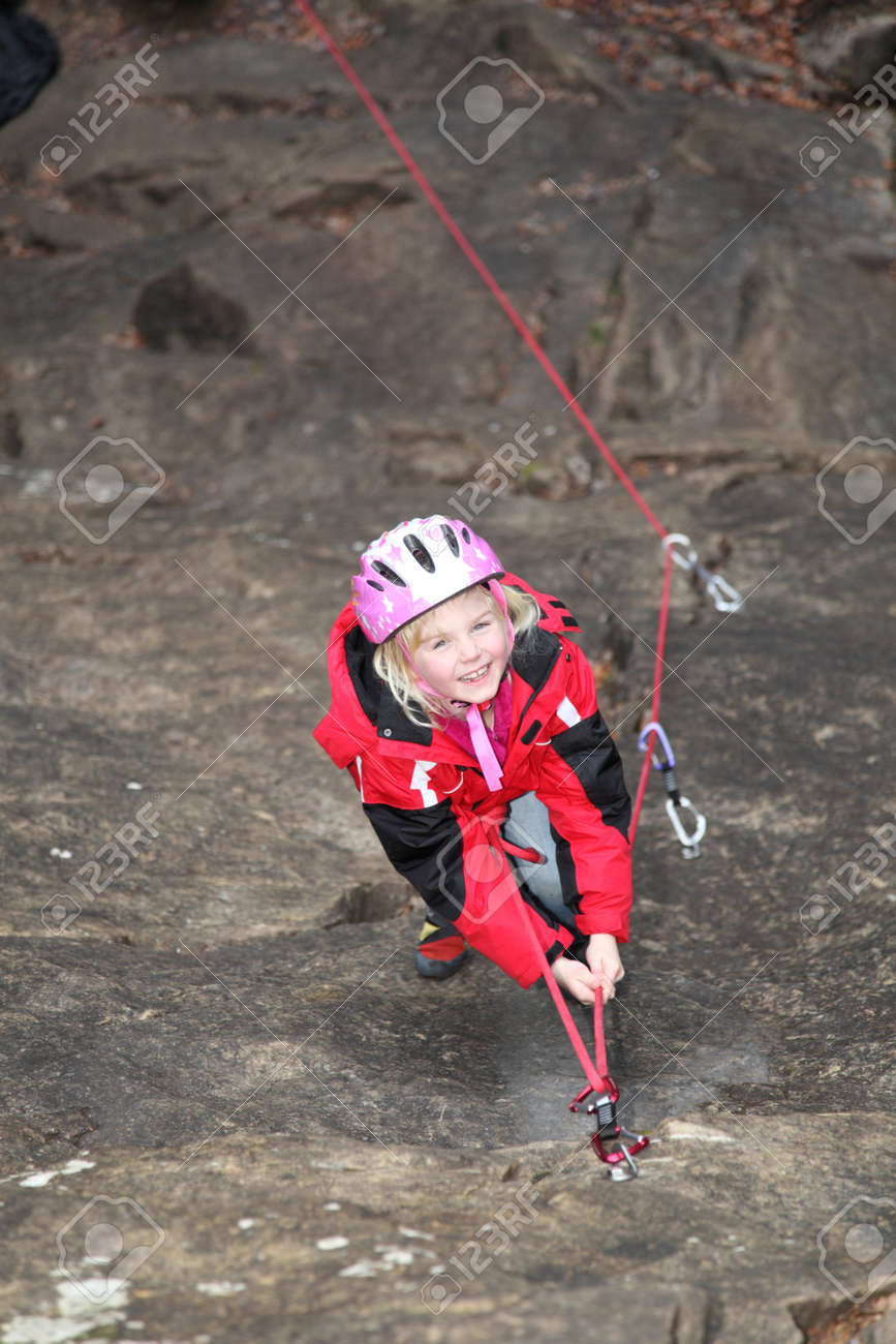 a young girl is smiling on a climbing wall Stock Photo - 17133428
