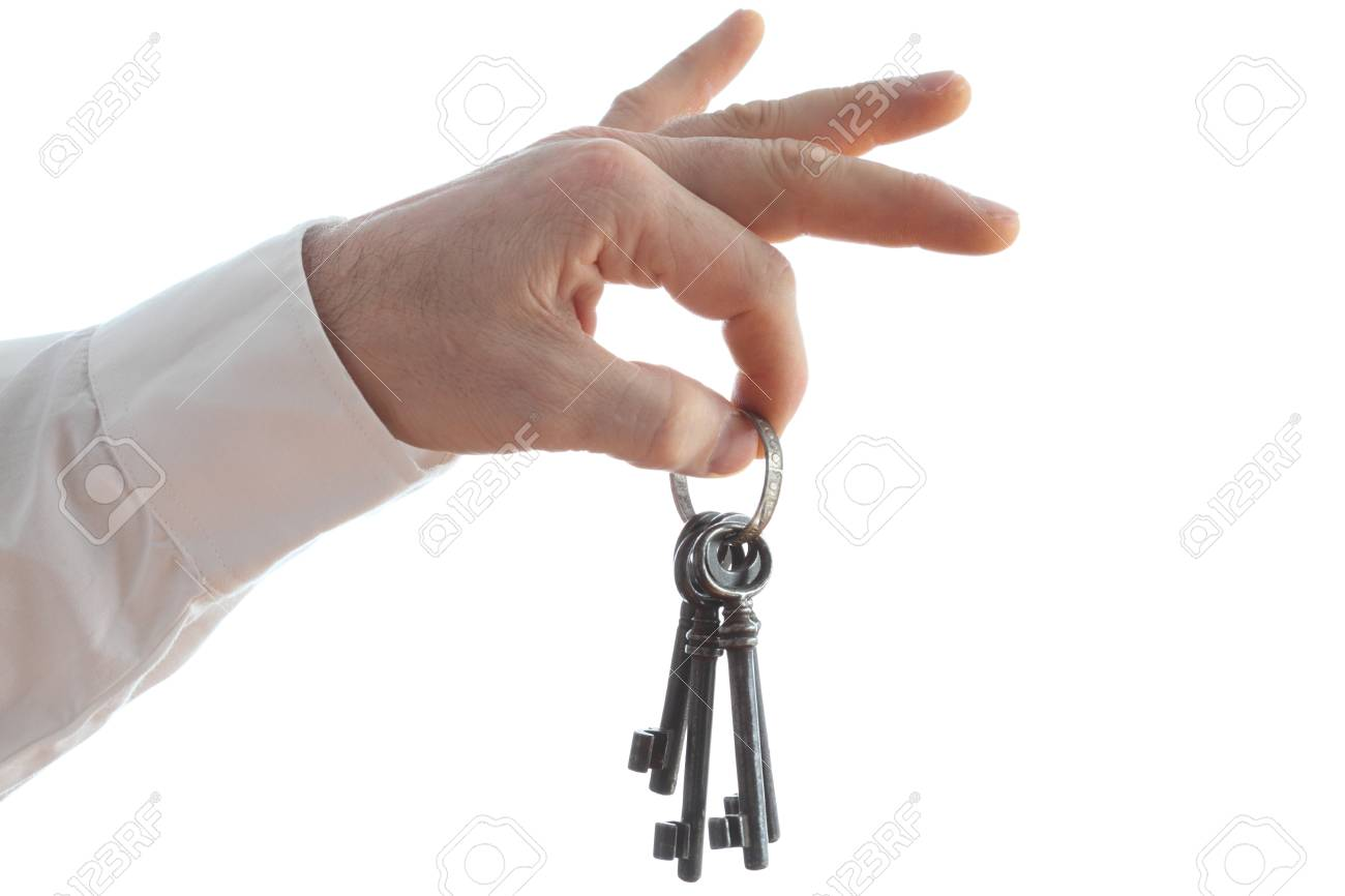 hand is holding a key ring with white background Stock Photo - 18437383