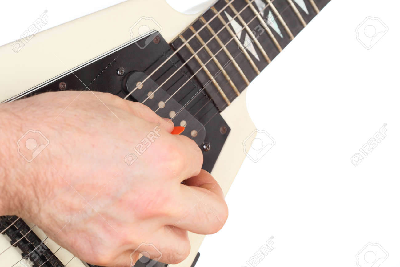 hand is picking with an electric guitar Stock Photo - 18522317