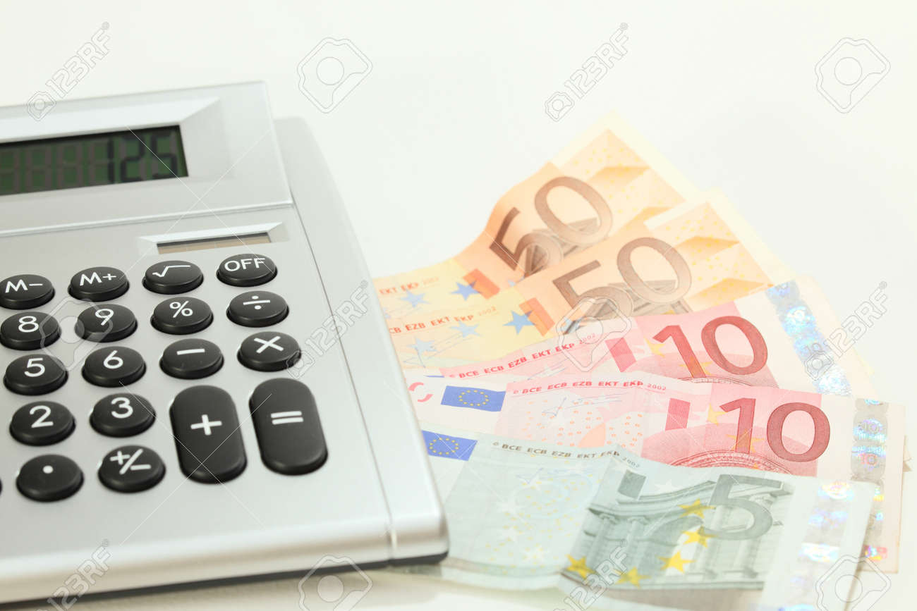 money and value with calculator on white desk