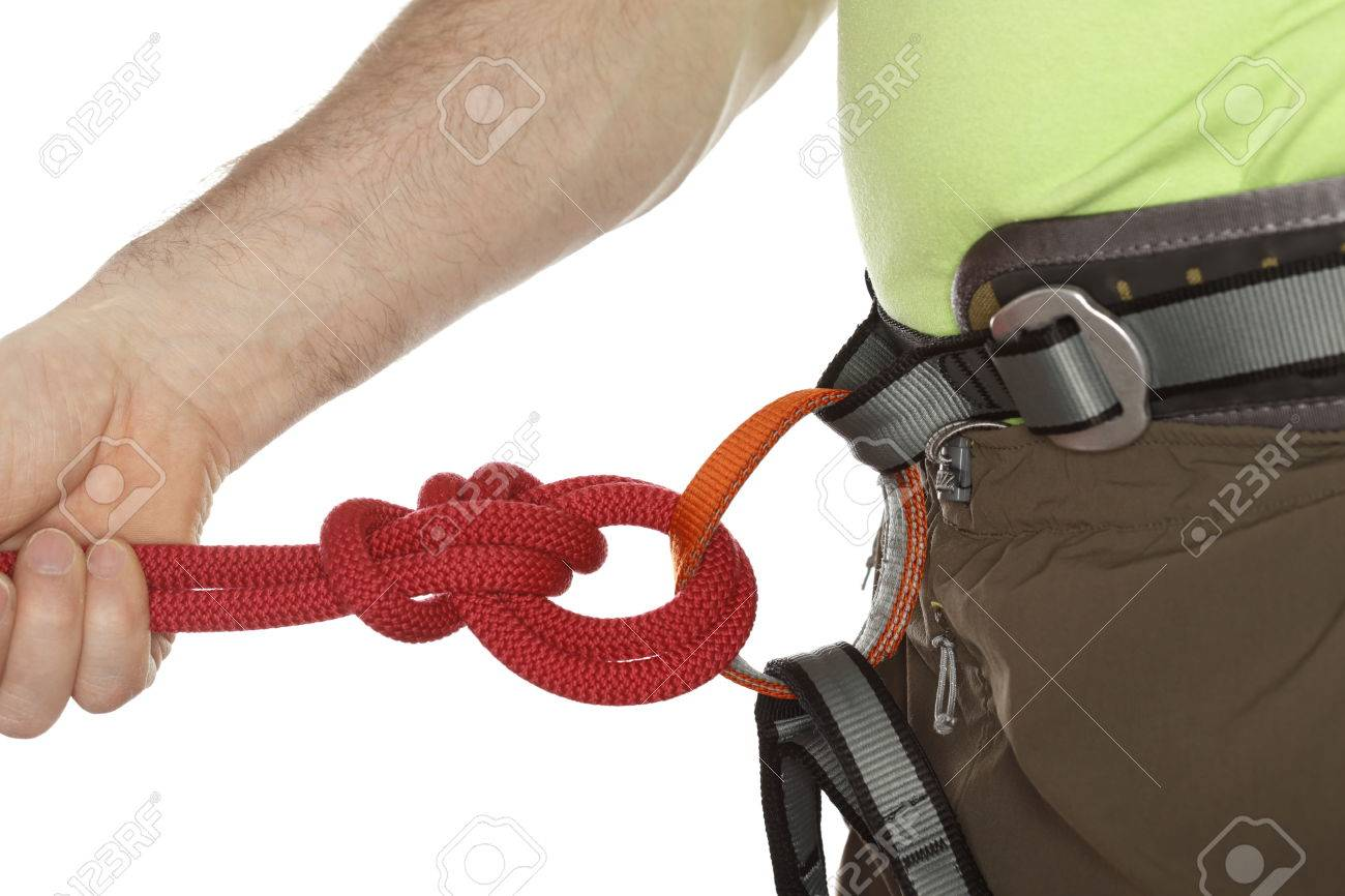 Seil Klettergurt Knoten : Sportkletterer mit grünen t shirt und seil knoten auf dem band