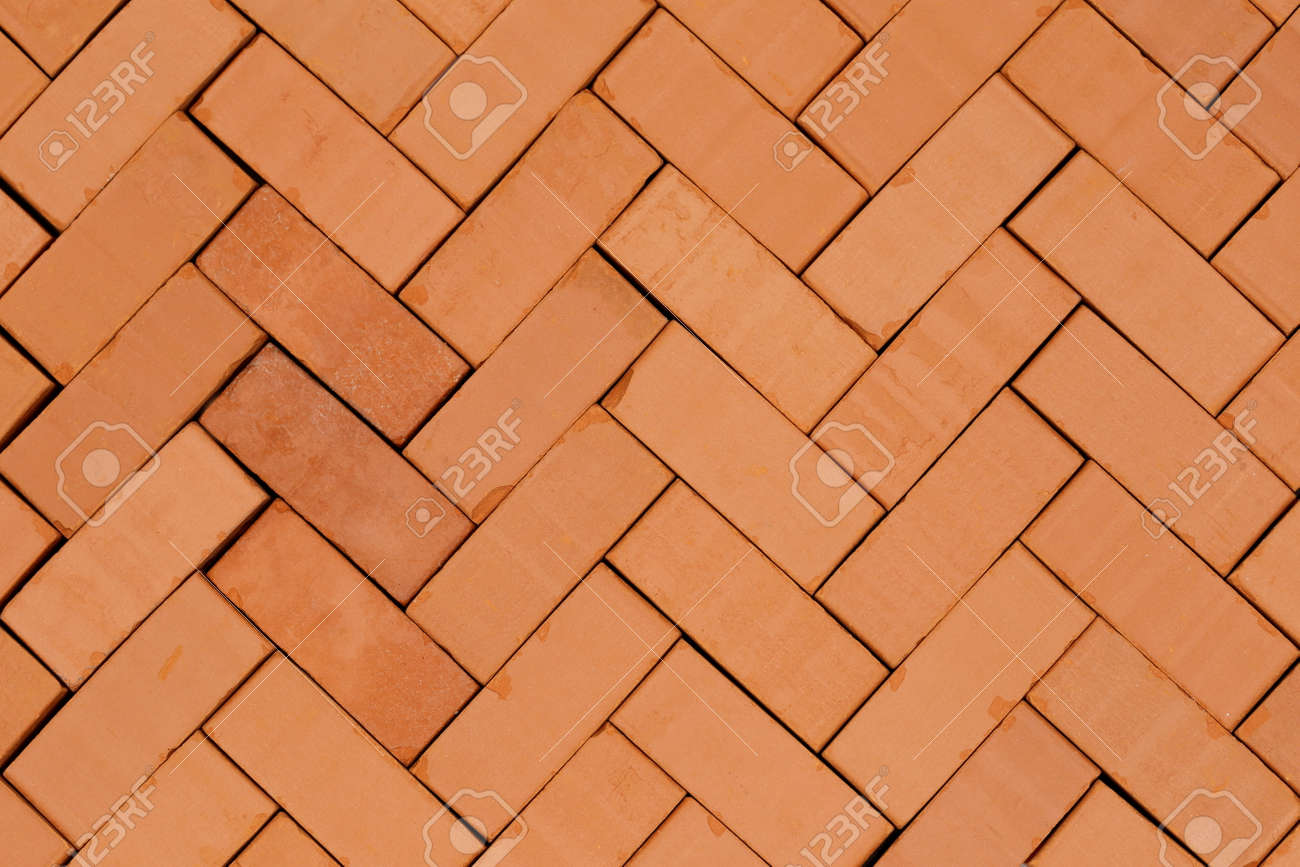fish bone pattern with red bricks on ground stock photo picture