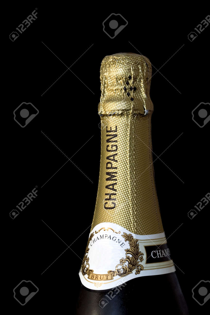 Champagne bottle top wrapped in gold foil, isolated against a black background. Stock Photo - 785362