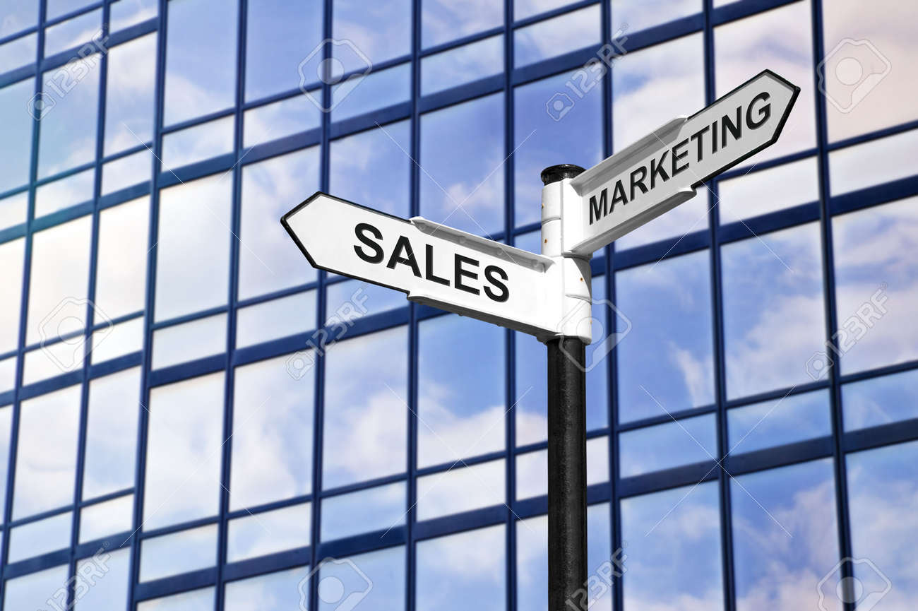 Concept image of Sales & Marketing on a signpost against a modern glass office building. Stock Photo - 2784480