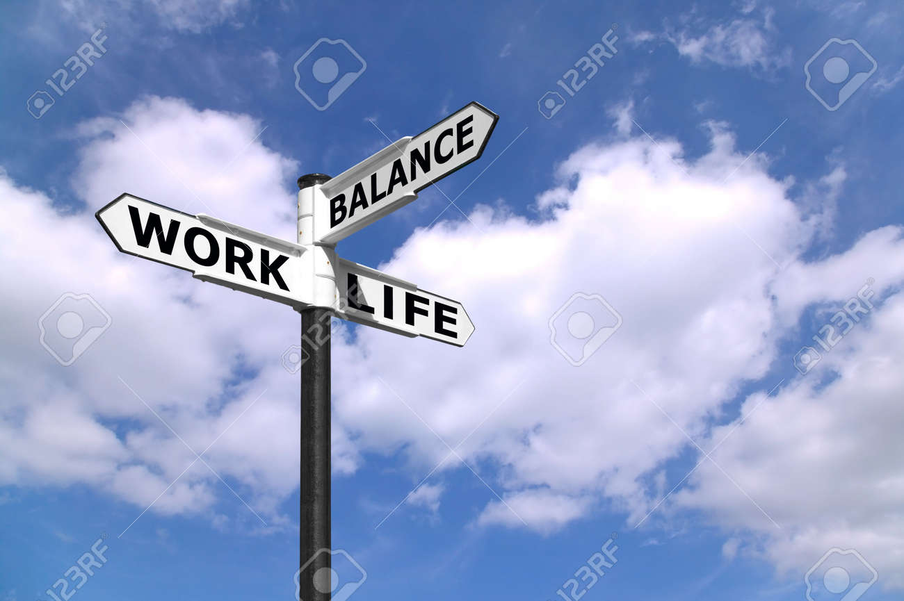 Concept lifestyle image of a signpost directing Work Life Balance against a blue cloudy sky. Stock Photo - 3053271