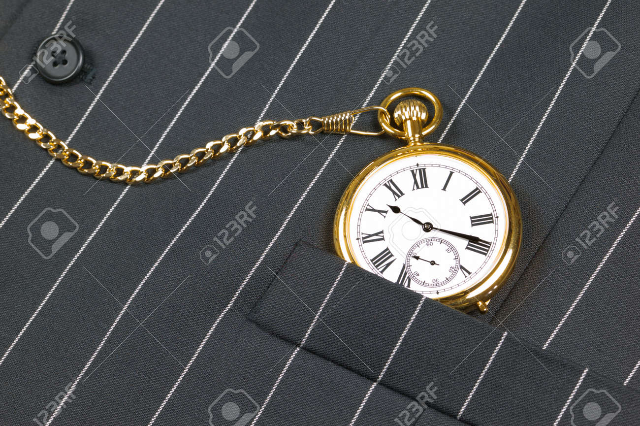 Gold pocket watch with roman numerals in the pocket of a waistcoat Stock Photo - 4113488
