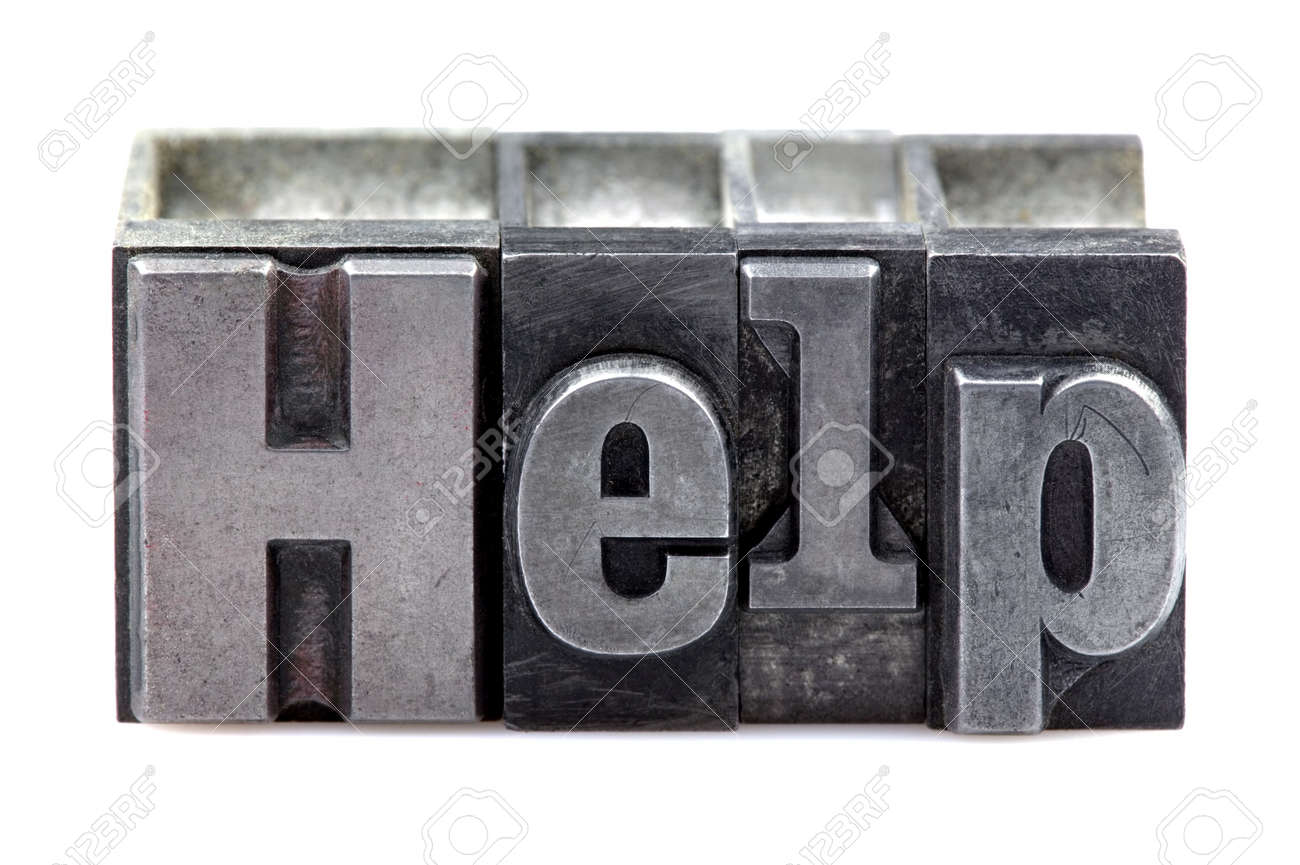 The word Help in old letterpress printing blocks isolated on a white background. Stock Photo - 4124506
