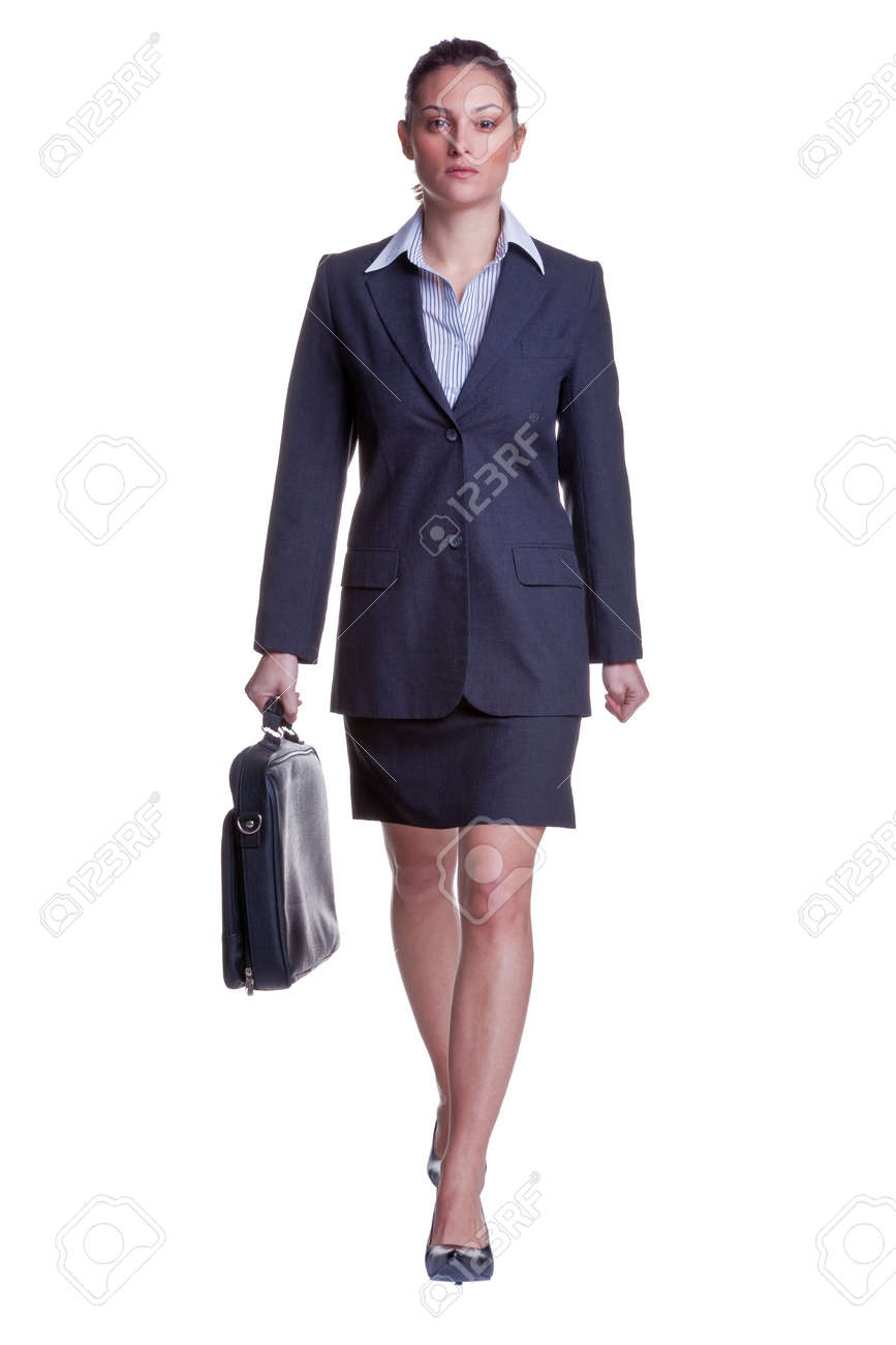 Businesswoman in suit walking towards carrying a briefcase, isolated on white background. Stock Photo - 4542053
