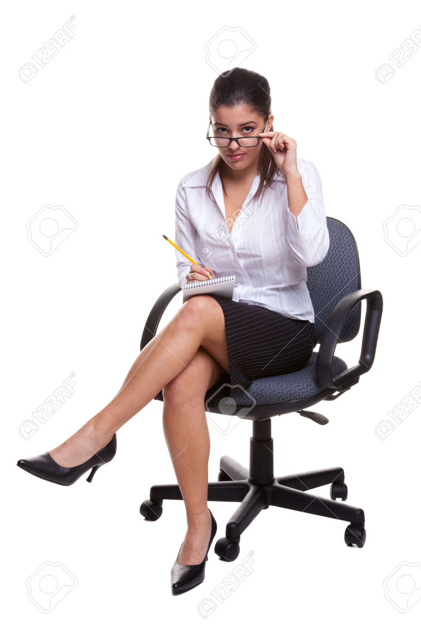 Secretary wearing glasses sitting on a swivel chair with notebook and pencil, isolated on white background Stock Photo - 4567804