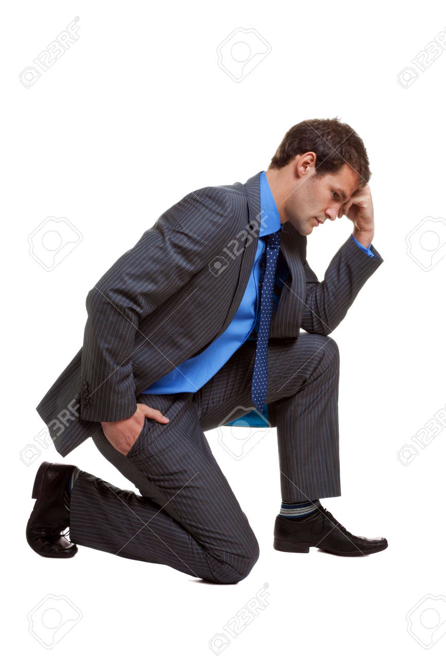 Image of a businessman in a pose known as The Thinker, isolated on white background with slight shadow at contact points. Stock Photo - 4905995
