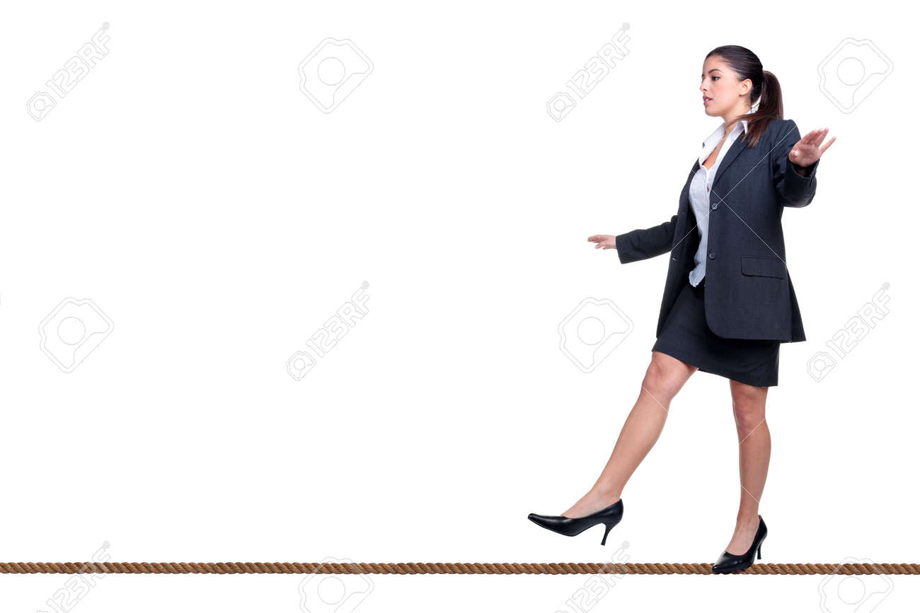 Businesswoman walking along a tightrope, isolated on a white background. Stock Photo - 5034203