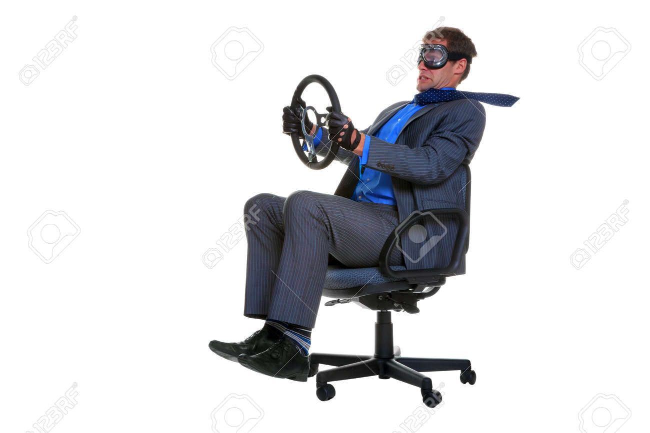 Concept image of a businessman driving along whilst sat in an office chair, isolated on a white background. Stock Photo - 5034201