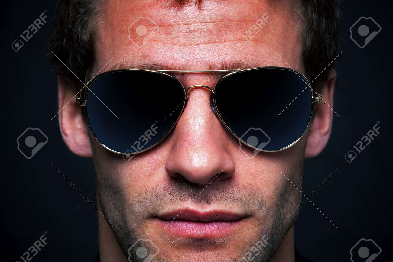 321a1c399 Close up portrait of a man wearing gold rimmed aviator sunglasses Stock  Photo - 5034220