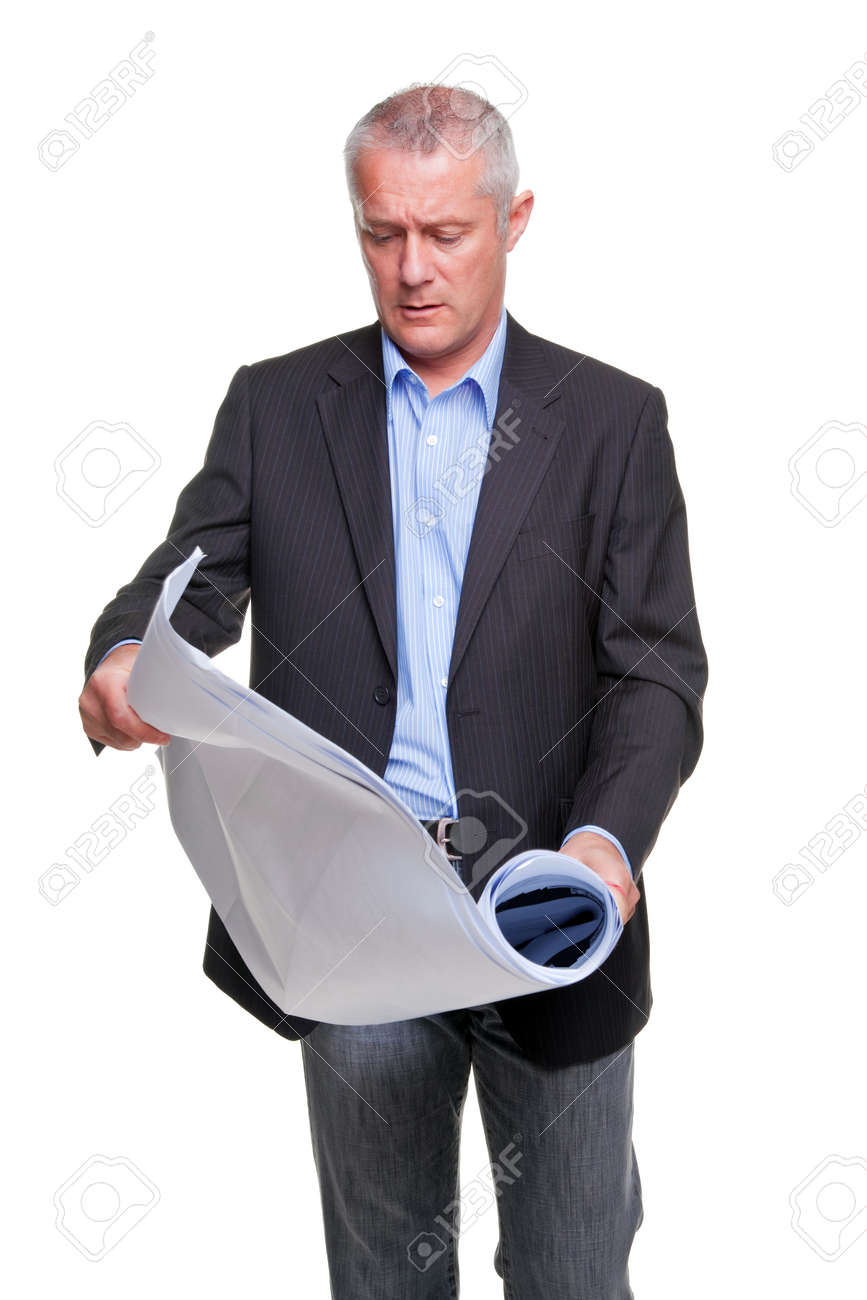 Male architect holding a set of building plans, isolated on a white background. Stock Photo - 5840819
