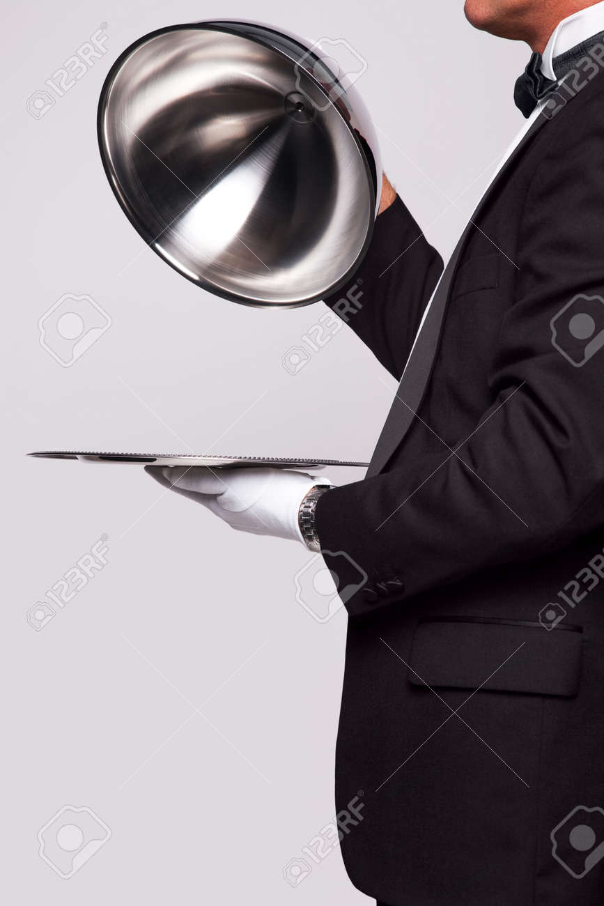 Butler lifting the cloche from a silver serving tray, insert your own object onto the tray. - 6444163