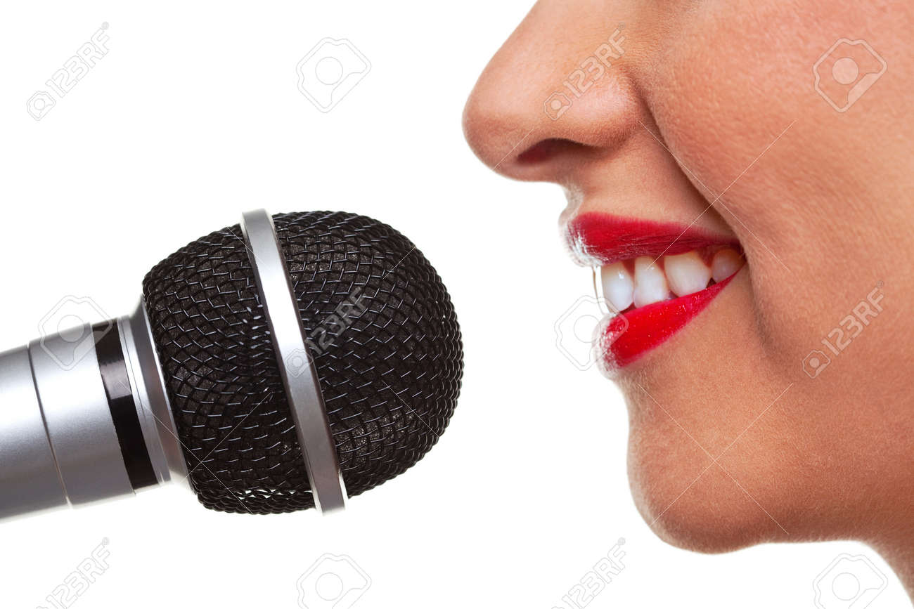 Close up of a woman using a microphone, isolated on a white background. Stock Photo - 7056891