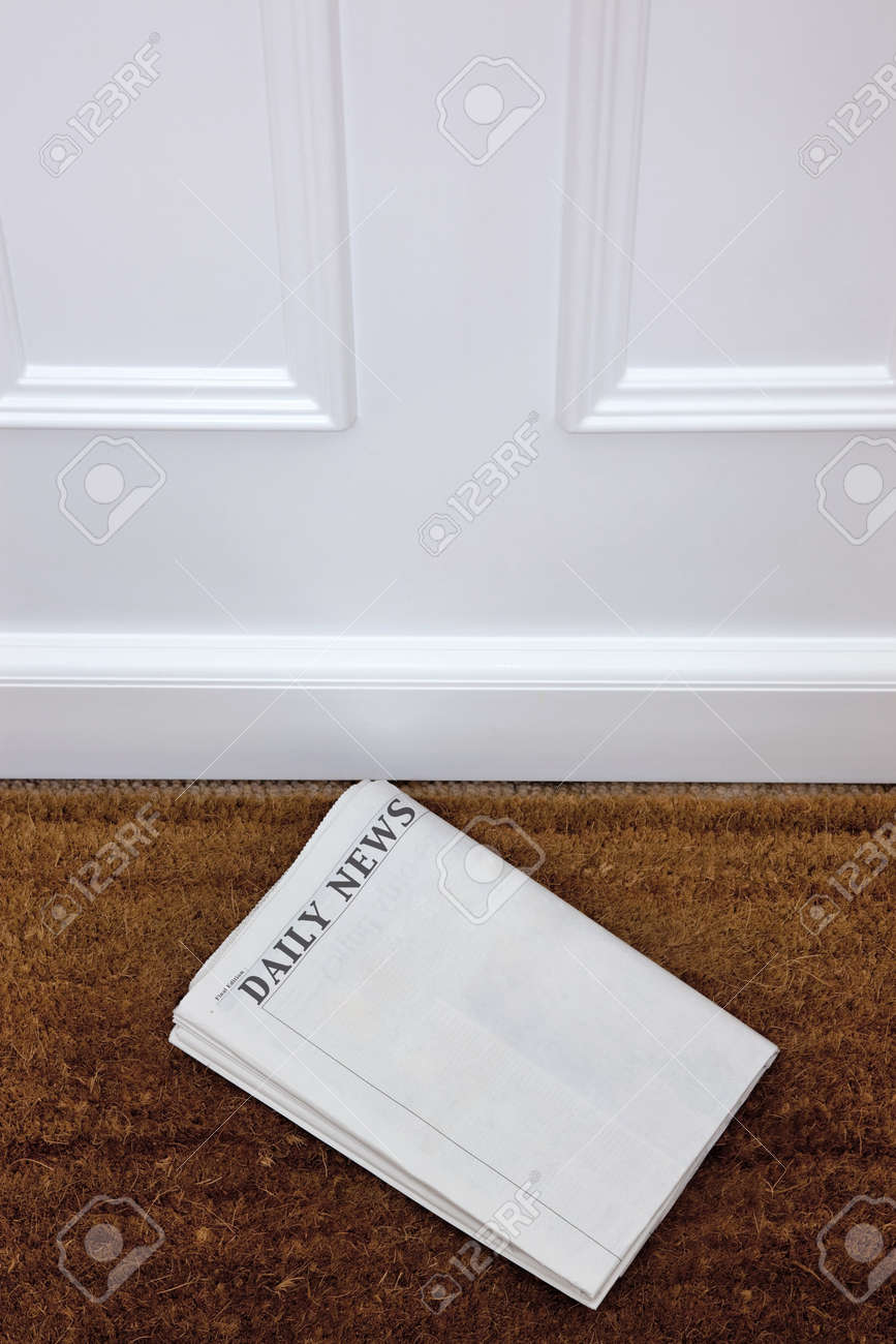 Newspaper lying on a doormat, blank to add your own text. Generic titles added by me. Stock Photo - 7057096