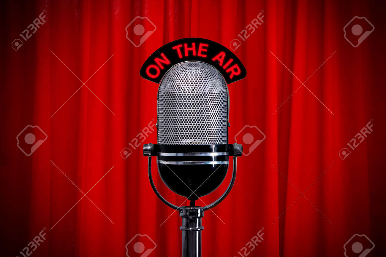 Red curtain spotlight - Retro Microphone On Stage Against A Red Curtain With Spotlight Effect Stock Photo 7971161